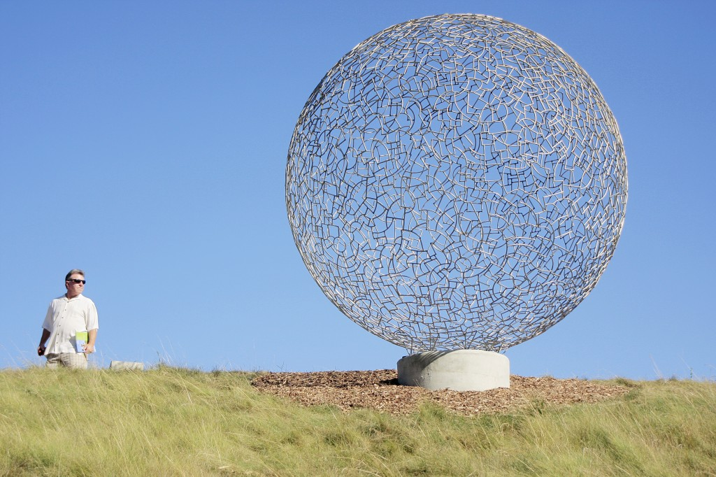 A guest checks out Ivan Mclean's Sphere 112. — Photo by Sara Hall ©