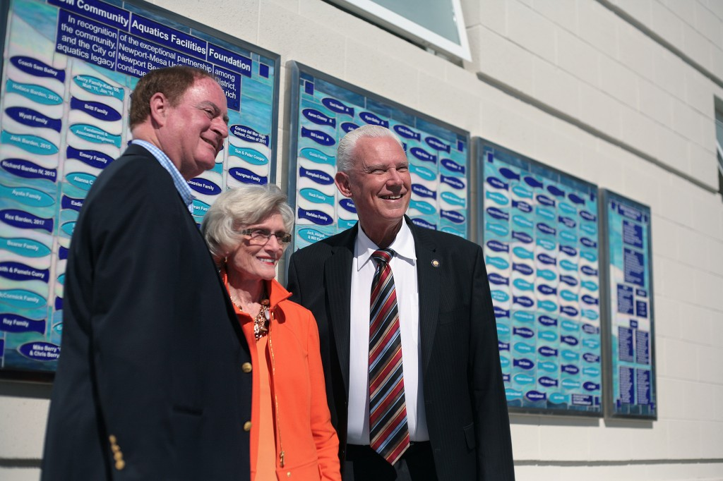 (left to right) Newport Beach City Councilman Keith Curry, former Assemblywoman and California State Senator Marian Bergeson, and NB Mayor Rush Hill pose for photos in front of the commemorative wall on Tuesday. — Photo by Sara Hall ©
