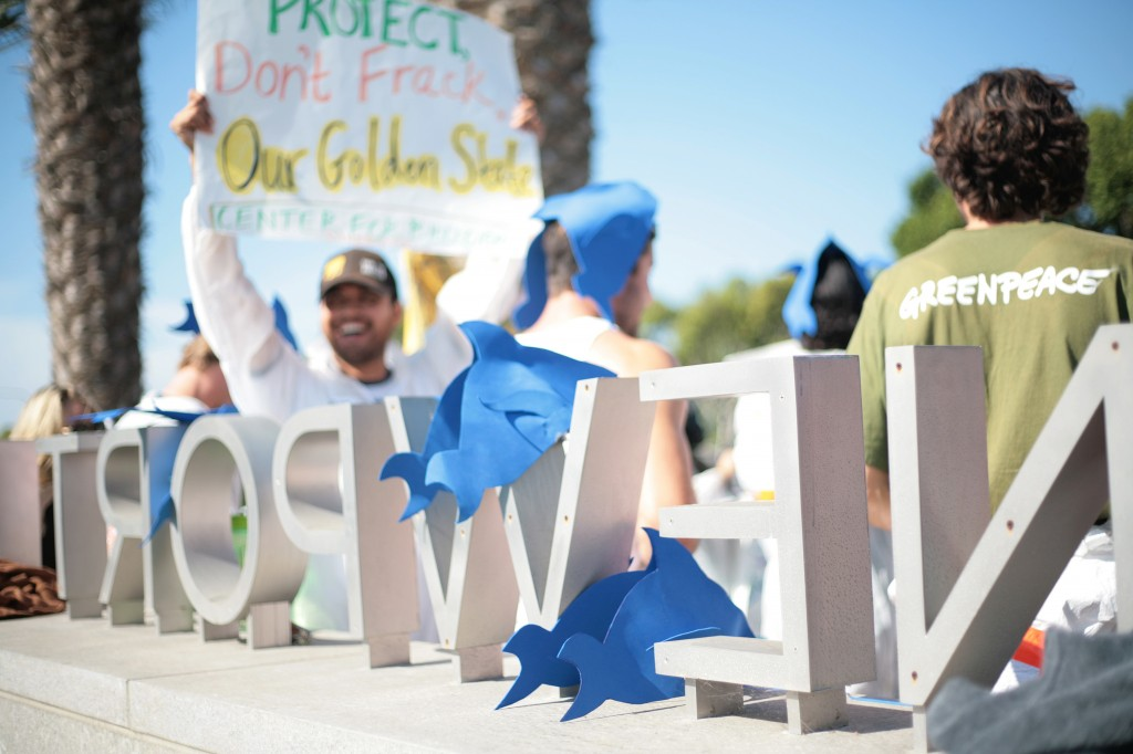 Fracking protesters wore fish hats, as well as others donning gas masks and hazmat suits, during a demonstration outside of Newport Beach Civic Center and City Hall, where CA Coastal Commission was meeting, on Wednesday. — Photo by Sara Hall ©