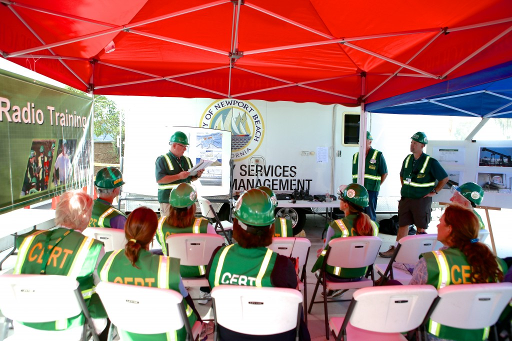 CERT volunteers listen to instructions before they learn how to use ham radios during the Drill the Skills event Saturday. — Photo by Jim Collins ©