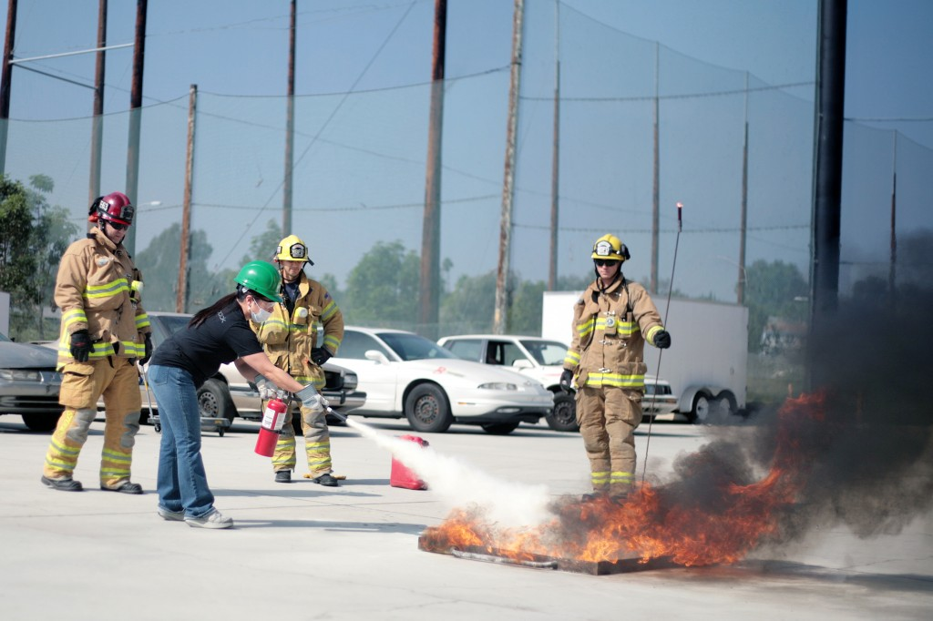 A CERT volunteer learns how to use a fire extinguisher during a class in early October.  — Photo by Sara Hall ©