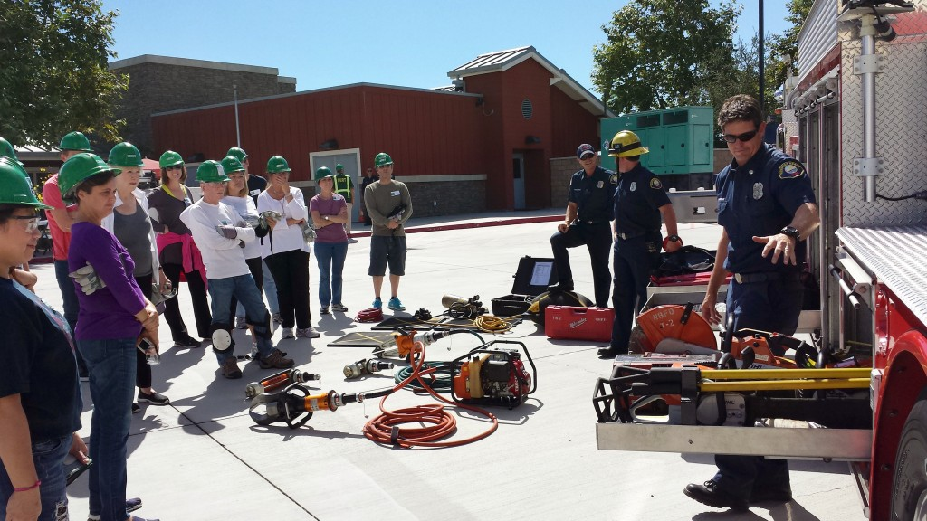 NBFD Fire Captain Brian McDonough talks about the equipment they carry on the fire truck during a CERT training class in early October. — Photo by Sara Hall ©