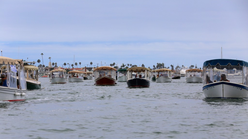 Duffy boats parading in Newport Harbor