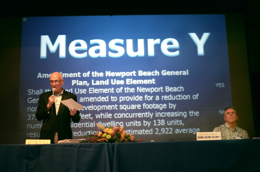Measure Y supporter Larry Tucker speaks about the measure during the Corona del Mar Resident's Association's forum as opponent Dennis Baker listens.  — Photo by Sara Hall ©