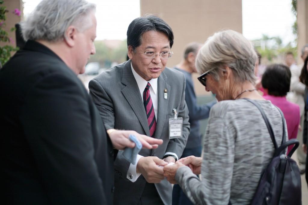Okazaki, Japan, Mayor Yasuhiro Uchida (middle) greets Newport Beach City Councilwoman Nancy Gardner as Seth Siegel of the Sister City Association helps translate. — Photo by Sara Hall ©