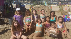 Girl Scout Troupe 731 in front of their sandy design. — Photo by Nichole Jasso