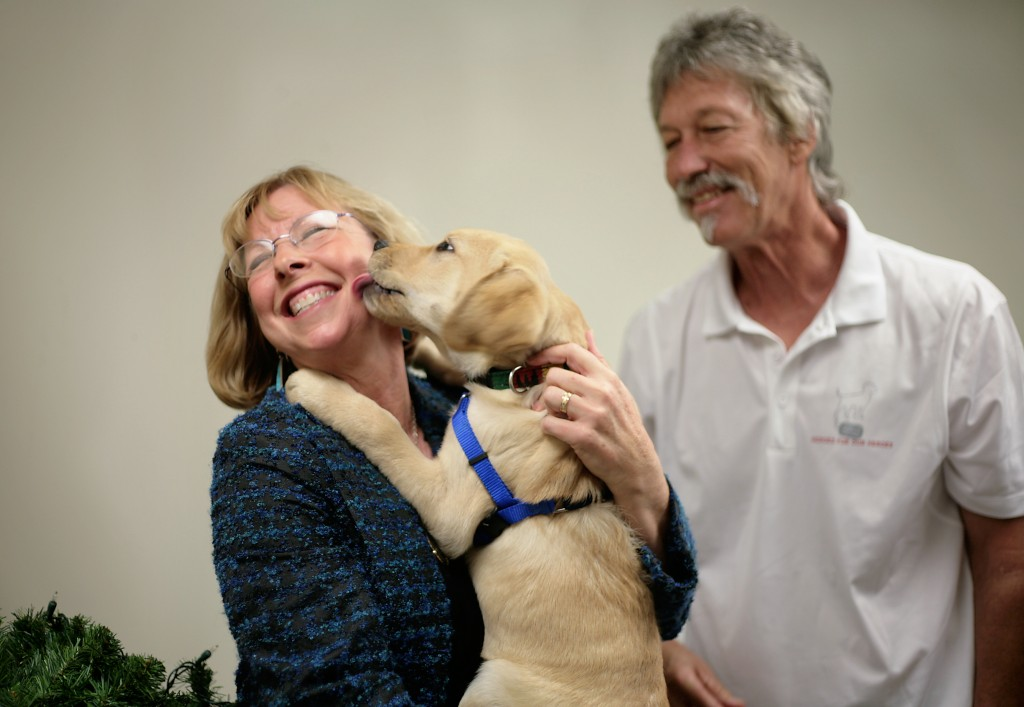 Cathy Ehlers Metcalf meets Freedom Dog-in-training, Walter's Honor. The puppy was named after her father, Walter Ehlers, who earned the Medal of Honor for his work on D-Day. Ehlers died February 20. He was 92.  — Photo by Sara Hall