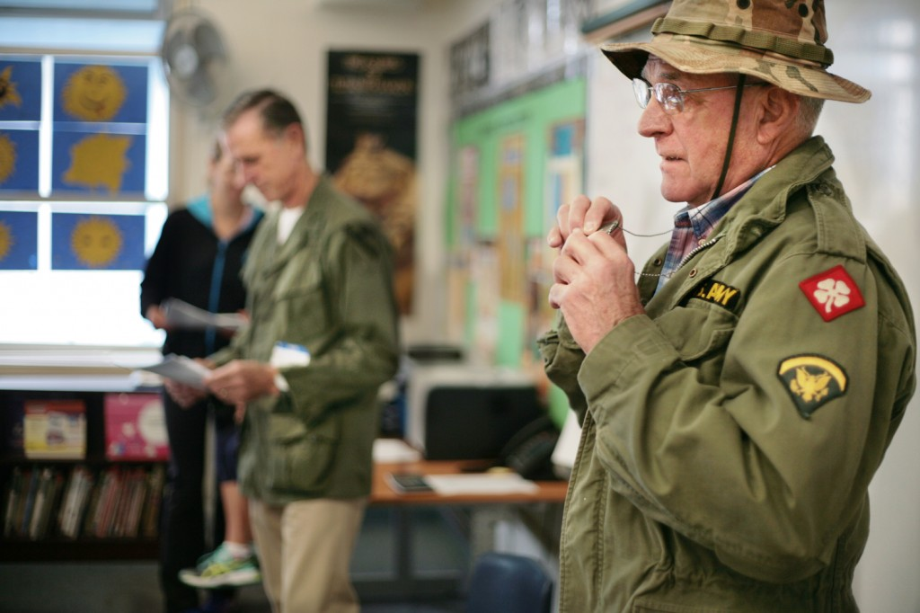 Brothers-in-law and Vietnam veterans (left) Mike Flenniken and Mike Dowd talk to a class at Mariners Elementary School about their experiences during the war.