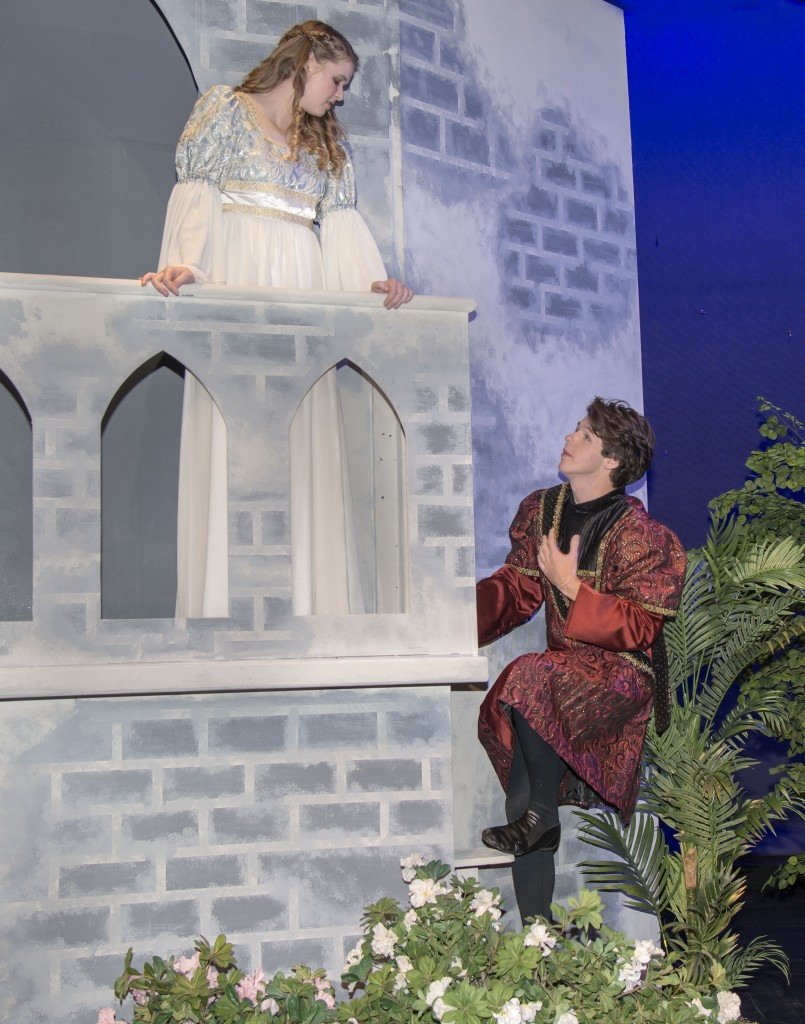 "Seniors Claire McCarthy, 17, and Cody Call, 18, perform the iconic balcony scene from ""Romeo and Juliet."" — Photo by Charles Weinberg"