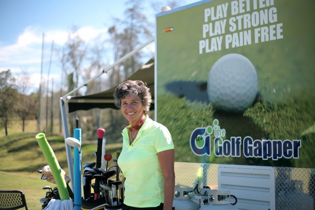 Jenni Martin with her Golf Gapper trailer.  — Photo by Sara Hall