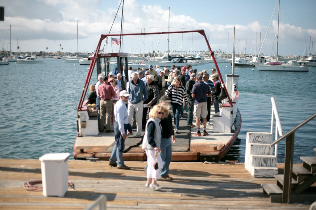 The crowd exits the ferry when the meeting/tour finished on Saturday at the Orange County Sheriff's Department Harbor Patrol visitor dock.   — Photo by Sara Hall
