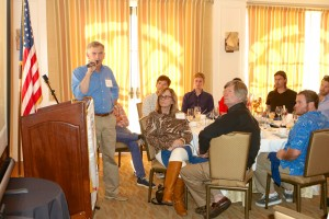 Pete Melvin speaks to the crowd at the luncheon, including his team at Morrelli and Melvin Design and Engineering, Inc., with Gino Morrelli sitting front and center. Photo by Jim Collins.