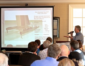 Pete Melvin explains one of the projects they worked on at their company. Photo by Jim Collins