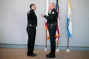 Jon Lewis gets sworn in as Newport Beach Police Department deputy chief by Lt. Jeff Brouwer.