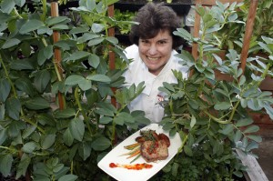 Chef Cathy Pavlos of Provenance Restaurant, pictured in her herb garden, wants diners to Seize the Dish during Newport Beach Restaurant Week