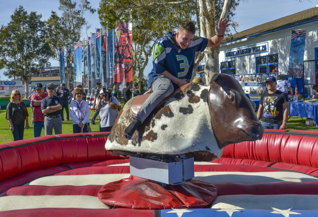 Marine riding bull at Super Bowl event