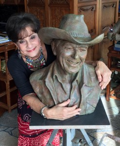 Miriam Baker with a bust of Ronald Reagan