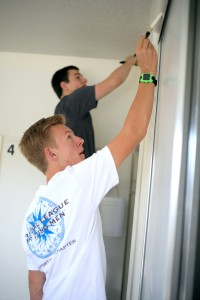 NLYM members Blake Richter, 15, and Ethan Zimmerman, 16, help paint a room at a Human Options housing location.