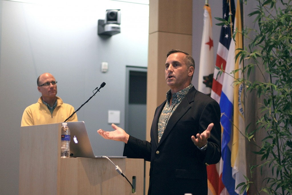 Newport Beach Harbor Commissioner Paul Blank talks about issues and projects related to the harbor as city Harbor Resources Manager Chris Miller stands in the background during Speak Up Newport's meeting on Tuesday. — Photo by Sara Hall ©