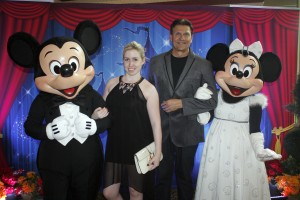Catherine and Christopher pose with Mickey and Minnie