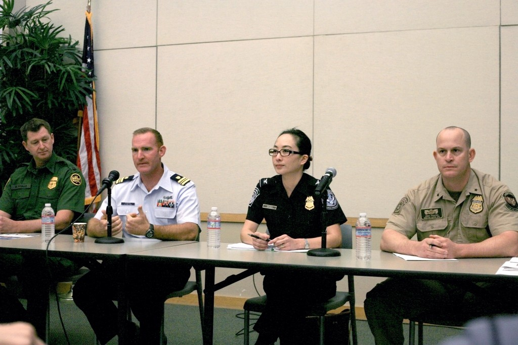 (left to right) U.S. Border Patrol agent in charge Mark Dunbar, U.S. Coast Guard Lt. Commander Beau Powers, Section Chief of Tactical Operations for U.S. Customs and Border Protection Cheryl Davies, and Director of Marine Operations for the Department of Homeland Security, Customs and Border Protection, and the Office of Air and Marine Jeremy Thompson, speak at Newport Beach Chamber of Commerce's Wake Up! Newport meeting on Thursday. — Photo by Sara Hall ©