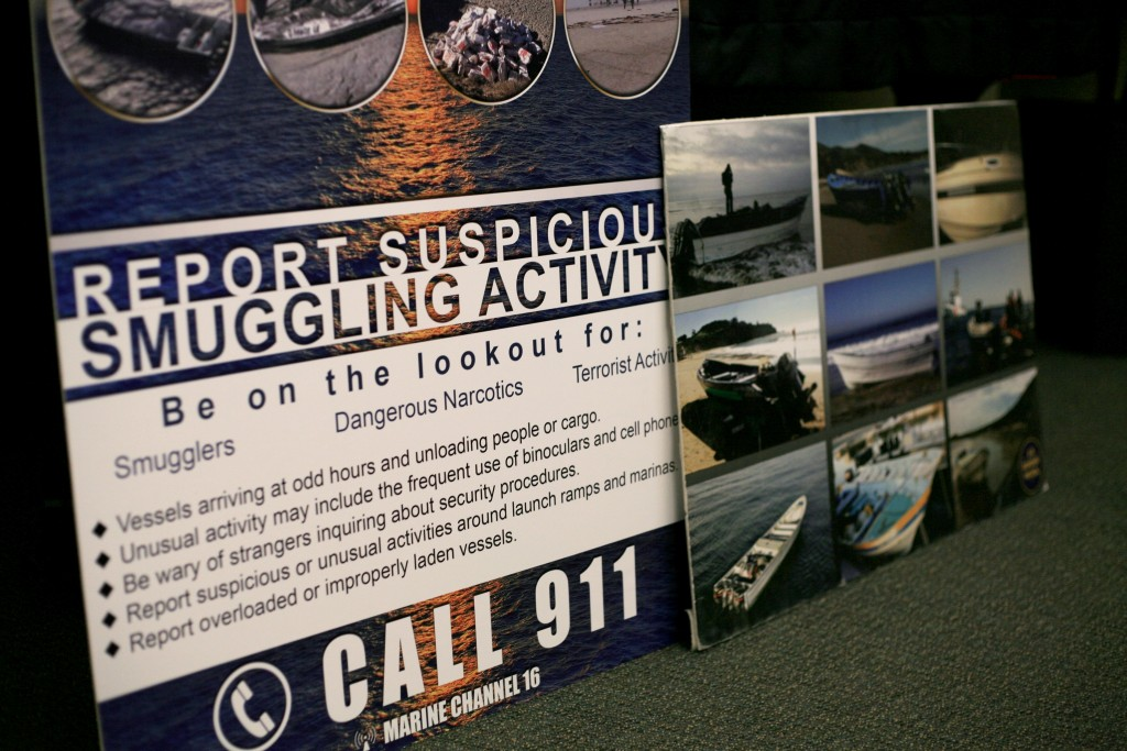 An informational graphic about smuggling activity warning signs was on display during the meeting.  — Photo by Sara Hall ©