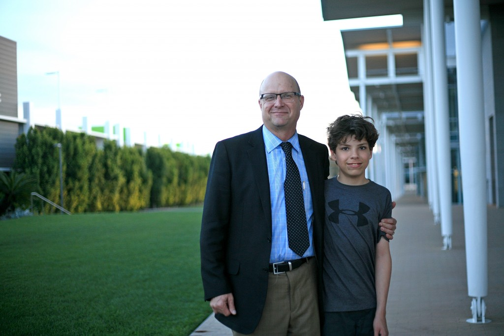 Stephen Camarata, Ph.D., an expert on late-talking children, and Jack Lessley, whose mother organized a lecture on the topic by Camarata in Newport Beach on March 14. Camarata has been working with Lessley since he was 3 years old.   — Photo by Sara Hall ©