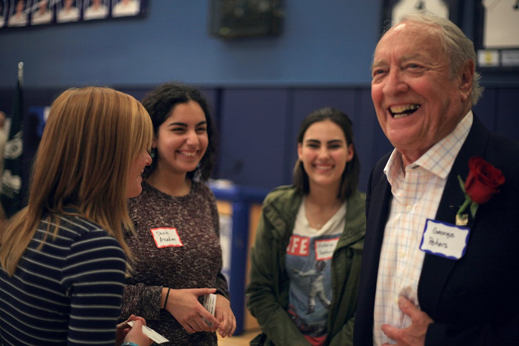 Korean War veteran George Peters laughs with his group of Corona del Mar High School students during the Living History program at the school last week.  — Photo by Sara Hall ©
