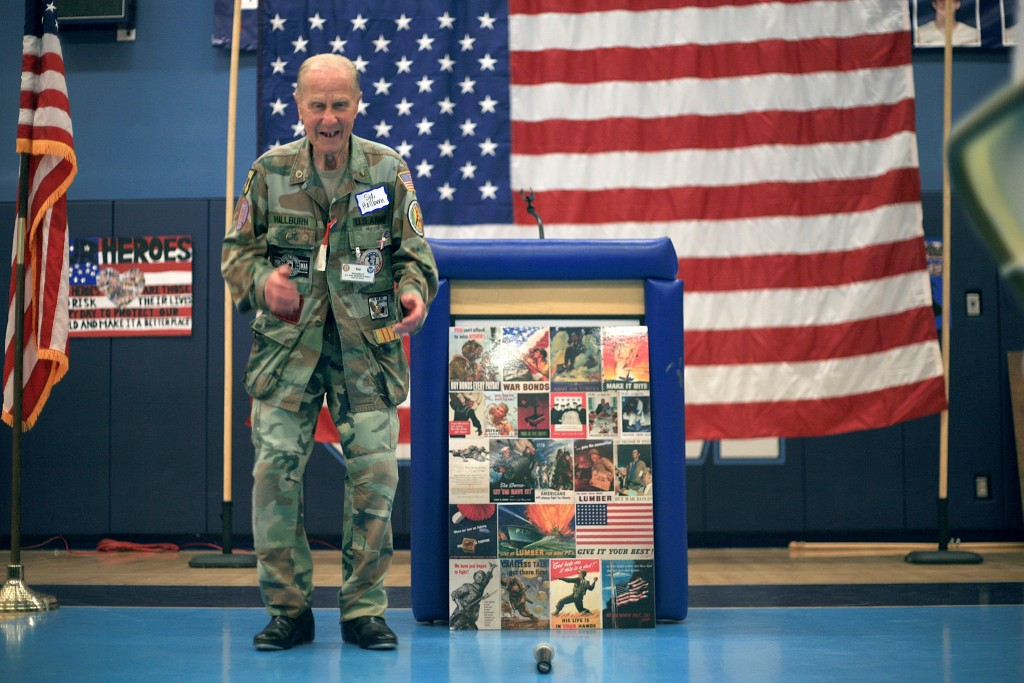 WWII veteran Sid Hallburn performs a tap dance routine for the students and his fellow veterans during the event.  — Photo by Sara Hall ©