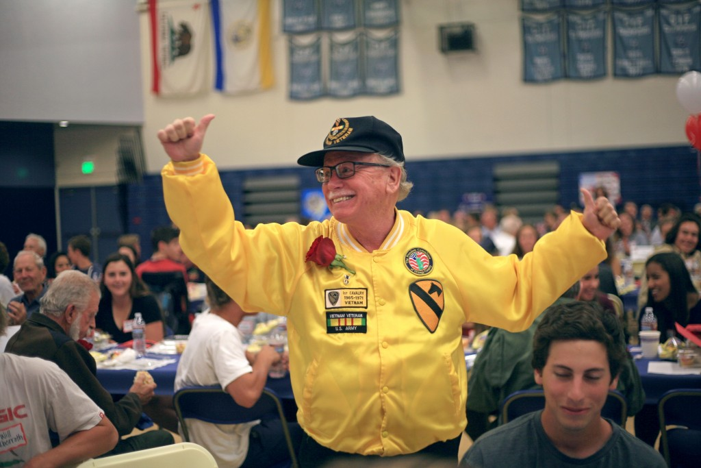 Vietnam veteran Ronnie Guyer waves hello to the crowd a his group of students introduce him. — Photo by Sara Hall ©