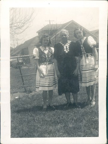 Bernadette Senn's mother (left), grandmother (center) and aunt wearing traditional Polish outfits.  — Photo courtesy Bernadette Senn ©