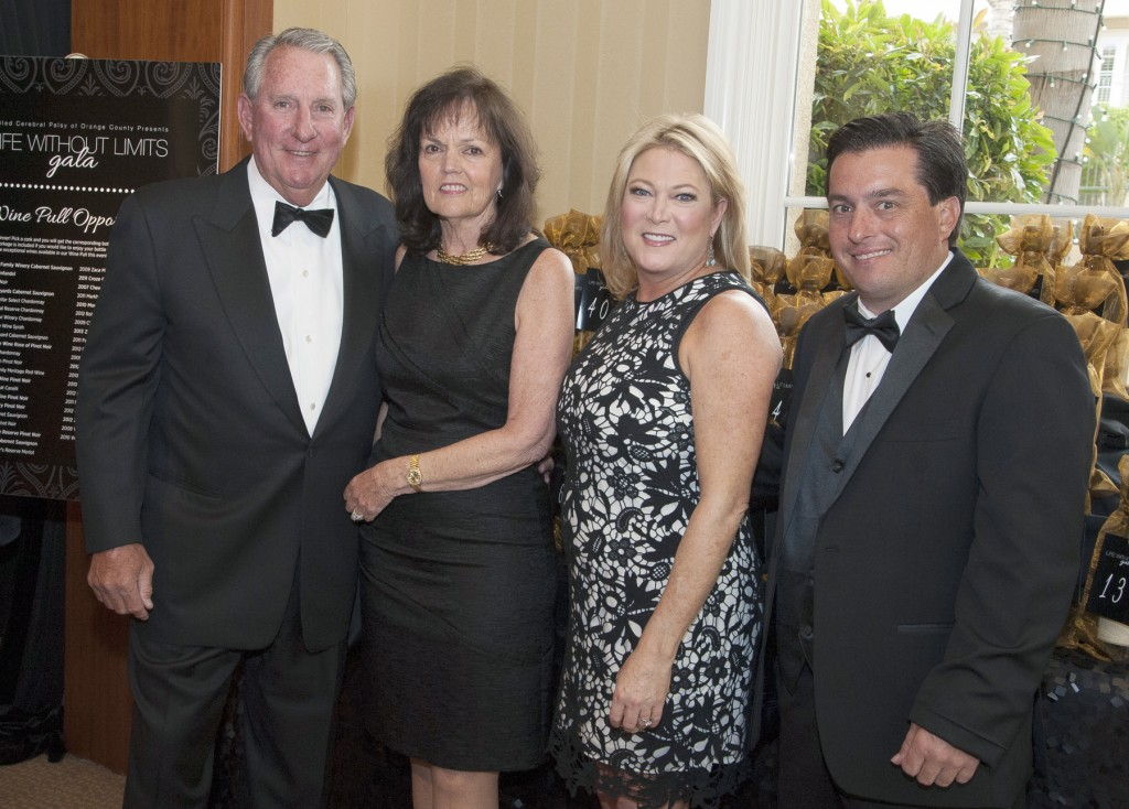 Honorees Chris, Kathy and Brain Dubia with UCP-OC CEO Deborah Levy at the United Cerebral Palsy of Orange County-Life Without Limits Gala. — Photo courtesy of United Cerebral Palsy of Orange County ©