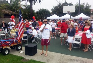 Former Mayor Mike Henn addresses the crowd at a 2013 Balboa Peninsula Fourth of July event