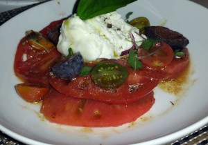 Burrata and heirloom tomato caprese with fig and basil, and 18 year balsamic vinegar