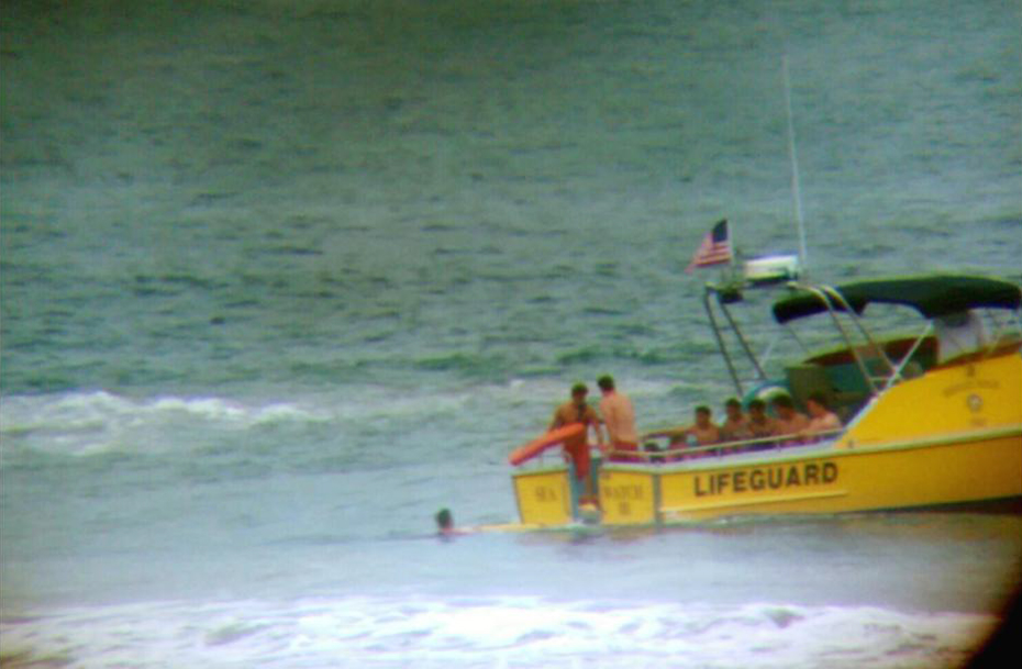 The Lifeguard Rescue Boat, with several youth safely on board, near Lifeguard Tower 18. — Photo courtesy the Newport Beach Fire Department ©