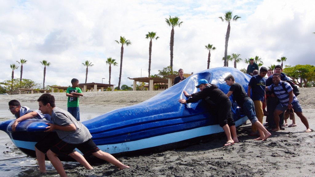 Children from the Speech and Language Development Center help push a giant floating whale into the Newport Dunes lagoon.   — Photo by Jenna Satariano ©