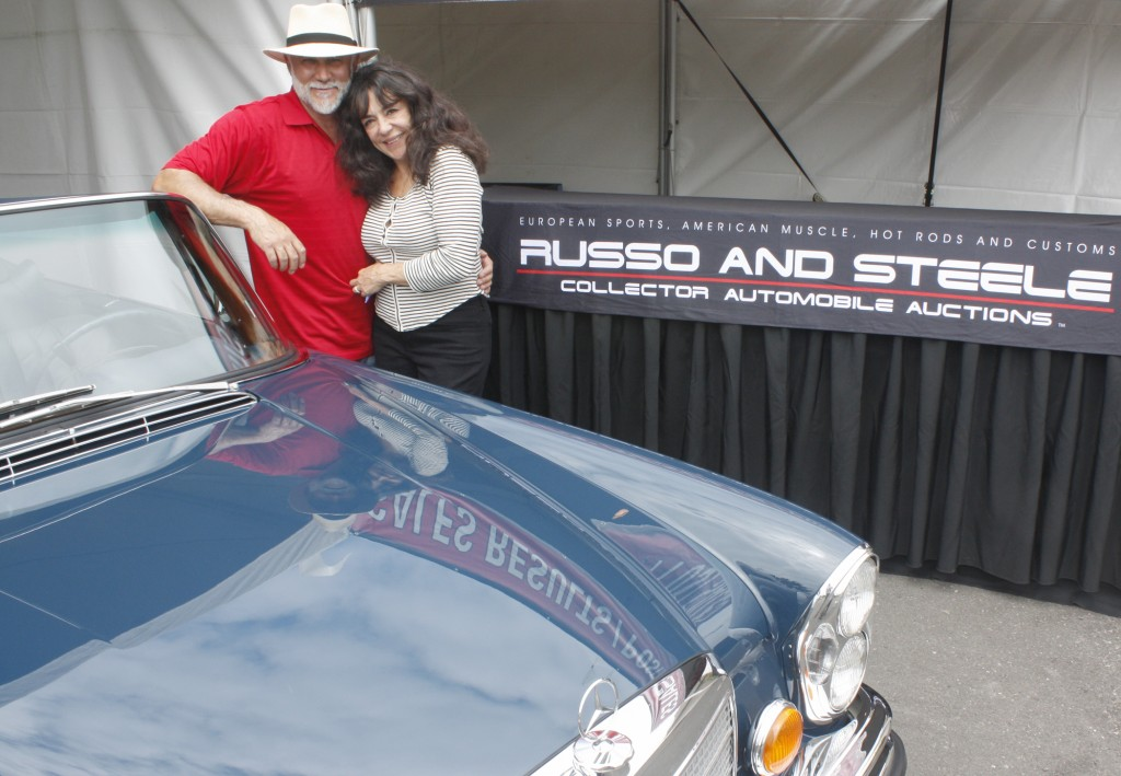 Russo and Steele owners Drew and Josephine Alcazar with a 1971 Mercedes 220 SE convertible that goes on the auction block this weekend at Newport Dunes. — NB Indy photo ©