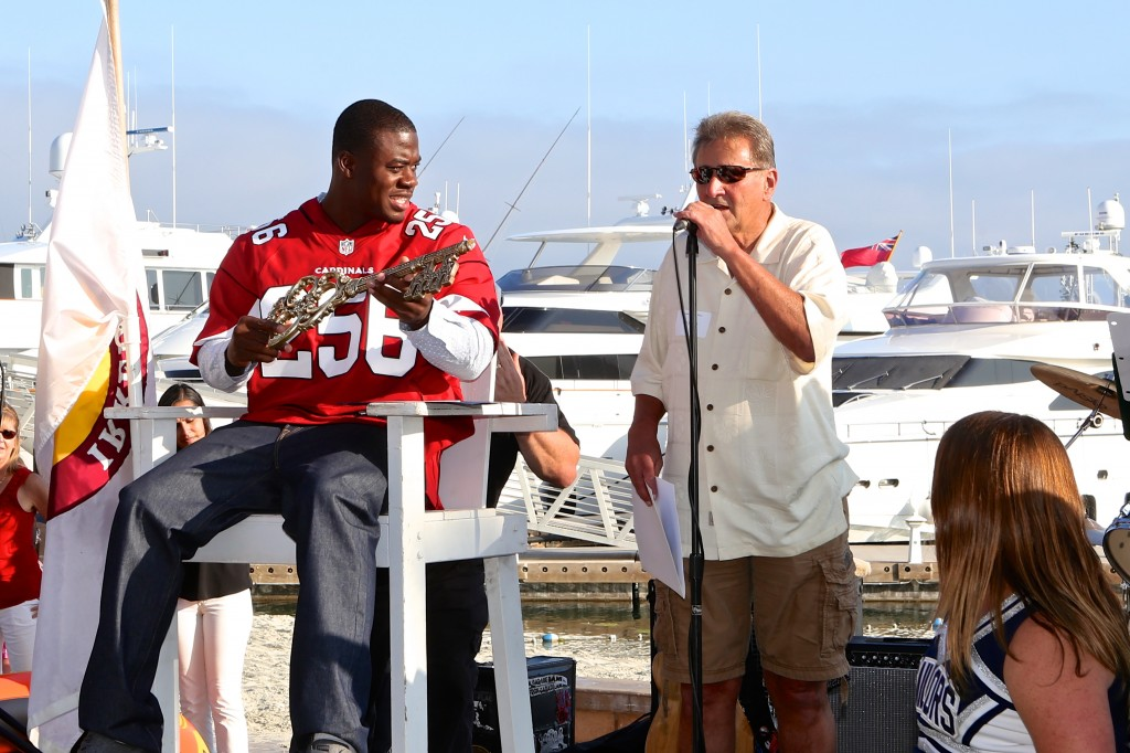 Newport Beach Mayor Ed Selich gives the key to the city to 2015 Mr. Irrelevant, Gerald Christian. — Photo by Jim Collins ©