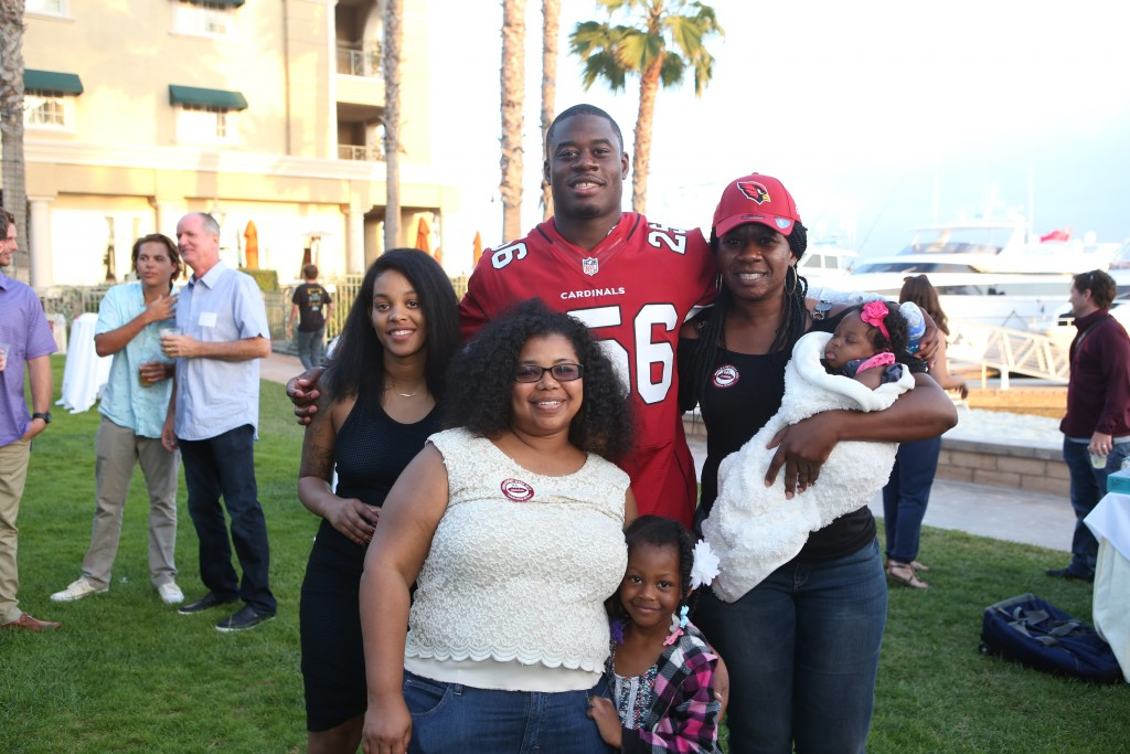 Mr. Irrelevant, Gerald Christian, and his family. — Photo by Jim Collins ©