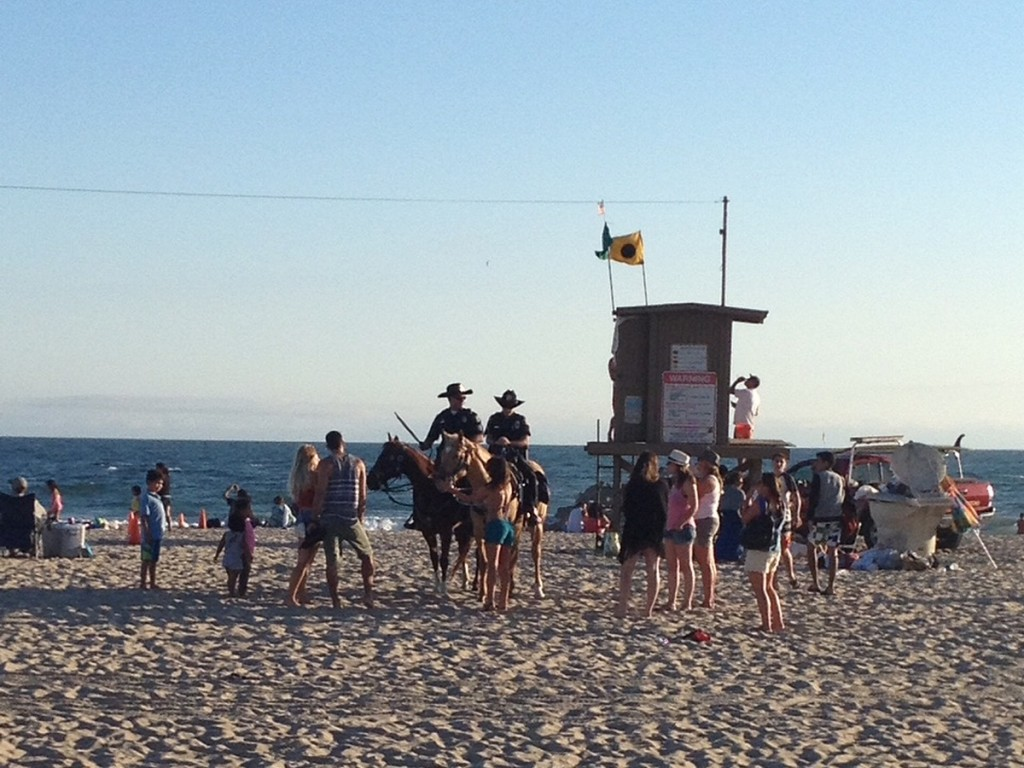 The Newport Beach Mounted Enforcement Unit at work on July 4. — Photo by David McGill ©