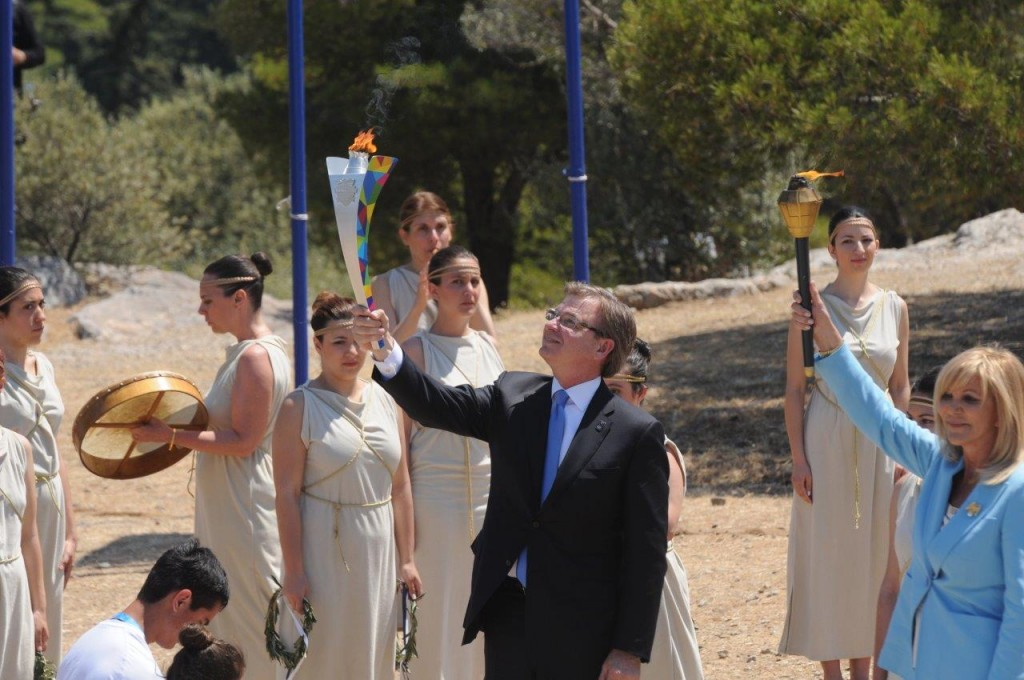 At the Torch Lighting Ceremony in Athens, Greece, Patrick McClenahan, Special Olympics World Games Los Angeles 2015 (LA2015), and Joanna Despotopoulou, Special Olympics Hellas President, stand with the Flame of Hope at Sacred Site of Pnyx.  — Photo by Vassilis Koutromanos/Courtesy Special Olympics