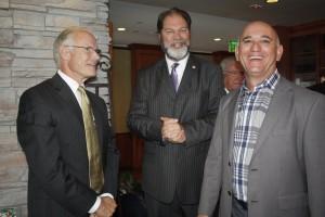 Newport Beach citizen of the Year Paul Watkins is congratulated by California State Senator John Moorlach and Newport Beach Chamber of Commerce President Steve Rosansky