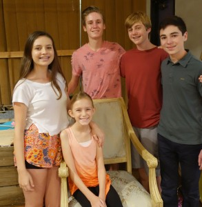 Newport Beach cast members Tessa Taylor, Christopher Huntley, Mitchell Huntley, Jaden Fogel, and Aoife McEvoy (seated)