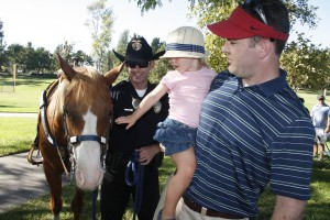 Officer Shawn Dugan and his horse Levi greet visitors to National Night Ouit