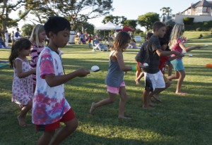 Kids enjoy an egg race during the Spyglass Hill National Night Out