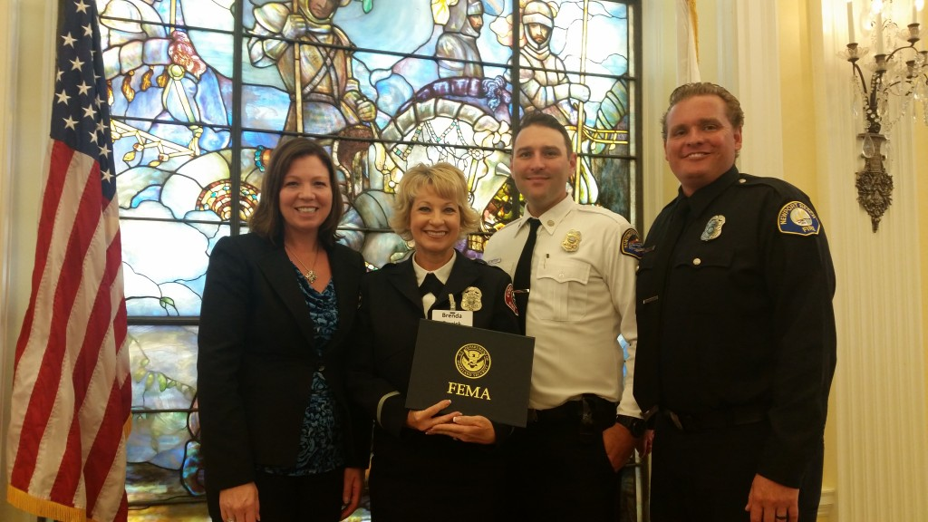 (from left to right) Donna Boston form the Orange County Operational Area, Brenda Emrick from Costa Mesa Fire Department, Brevyn Mettler from Huntington Beach FD, and Newport Beach CERT program leader and NBFD Life Safety Specialist Matt Brisbois in Washington DC accepting the 2015 FEMA Individual and Community Preparedness Award for Outstanding CERT Program Initiatives on behalf of Orange County CERT Mutual Aid Program. — Photo courtesy Matt Brisbois ©