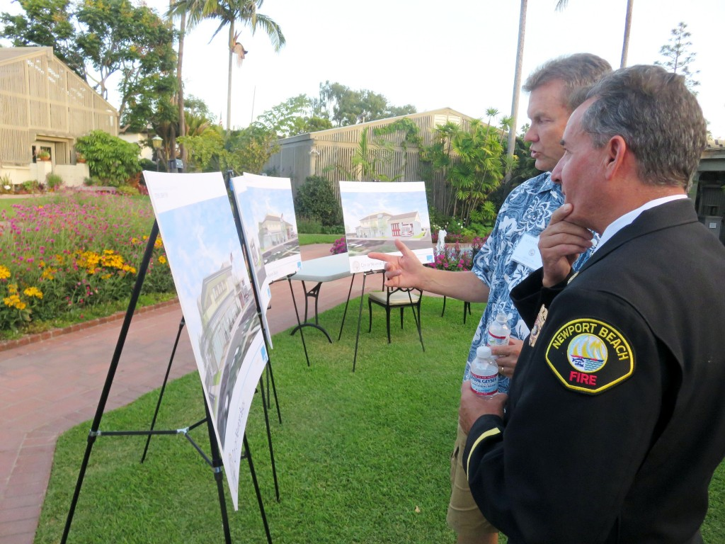 Newport Beach City Councilman Scott Peotter (left) and NB Fire Chief Scott Poster view and discuss the options for the Corona del Mar fire station and library project at a community meeting Monday. — Photo by Sara Hall ©