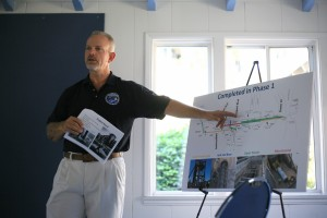 Project Manager Don Cutler talks about the Mariner's Mile sewer pipe construction project during a community meeting on Saturday.