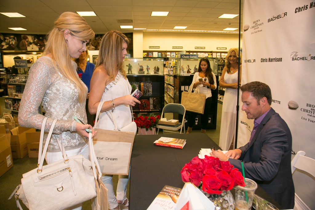 Local residents Debra Klein and Bree Cox with Chris Harrison. — NB Indy Photo ©