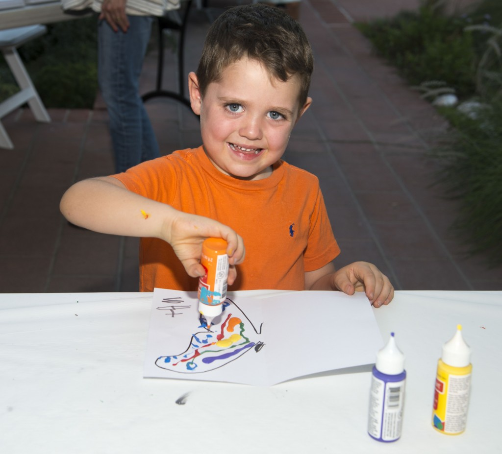 Max Buccola, 4, painting during the event.  — Photo by Lawrence Sherwin ©